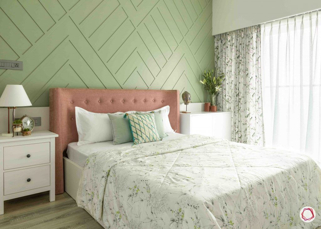 painting ideas-pastel accent wall-textured paint-bedroom-headboard-white cabinets-sea green room