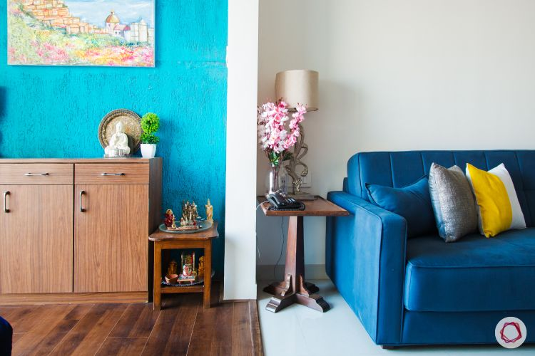 painting ideas-adjacent zones-blue accent wall-blue couch-side tables