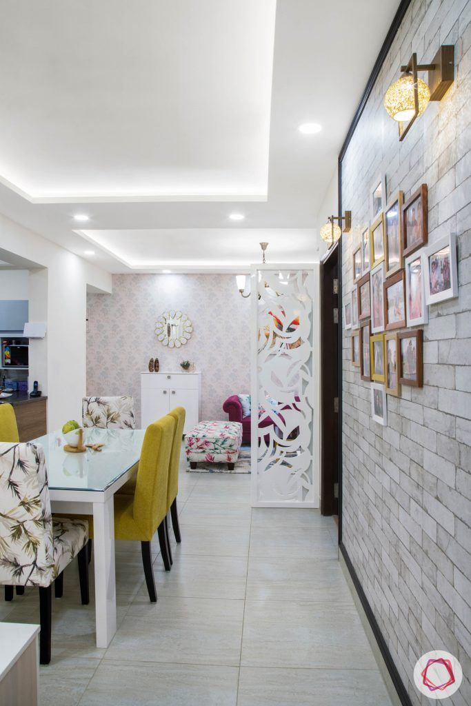 Cleo county noida_dining room with photo wall on exposed brick wallpaper