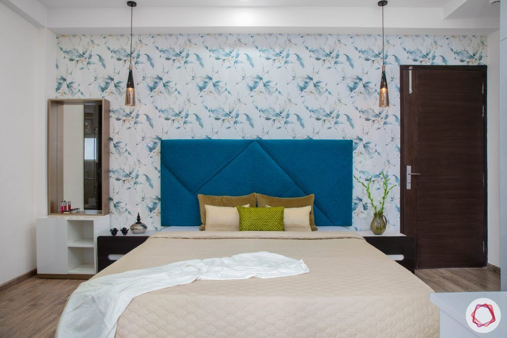 Cleo county noida_master bedroom with floral wallpaper and pendant lights