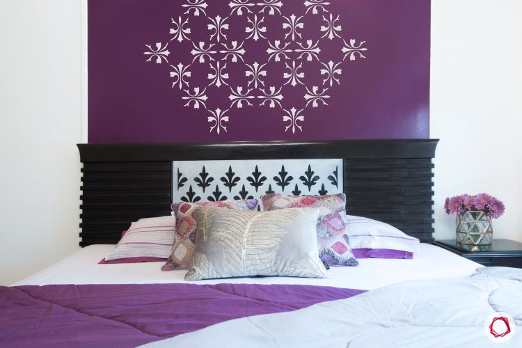 wall paint colours-bedroom-wooden bed-purple pattern wall