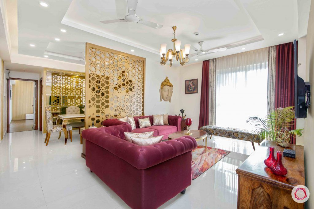 3 bedroom flat design-tufted sofa-art silk sofa-white and gold wallpaper-ethnic accent pieces