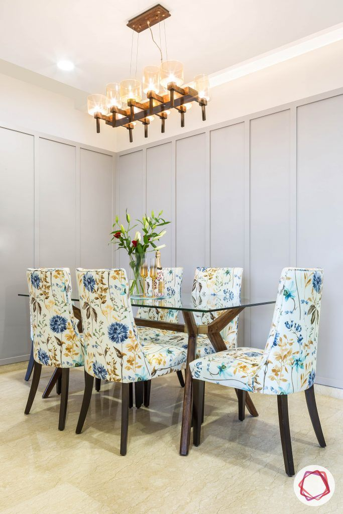 lodha group-dining room designs-glass dining table-floral dining chair designs