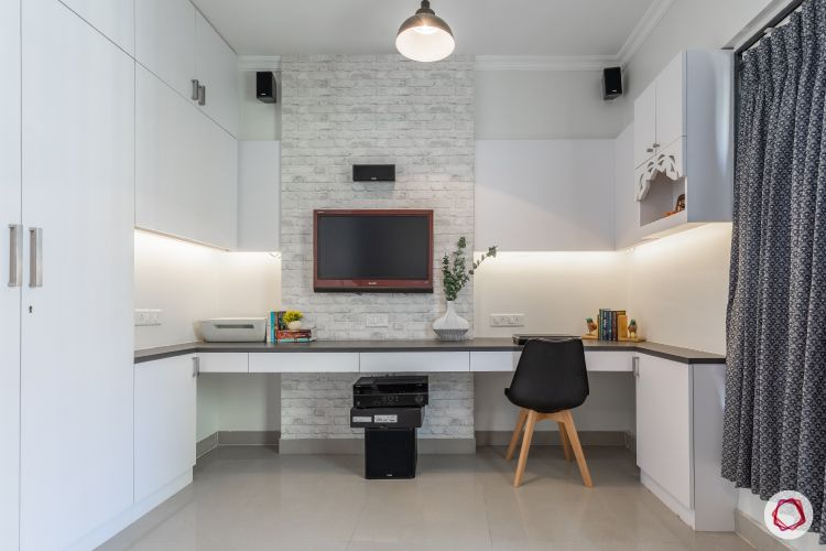 study room-study table-exposed brick wallpaper-wall mounted tv