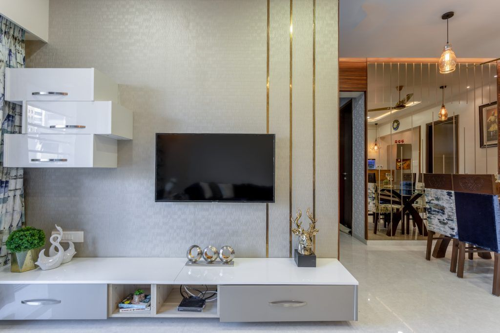 grey-white-wallpaper-gold-lamp-drawers-dining-chairs