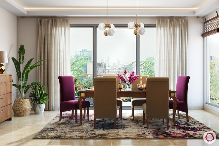twinkle khanna-dining-room-upholstered-chairs-light-rug-plant-buffet-table-painting