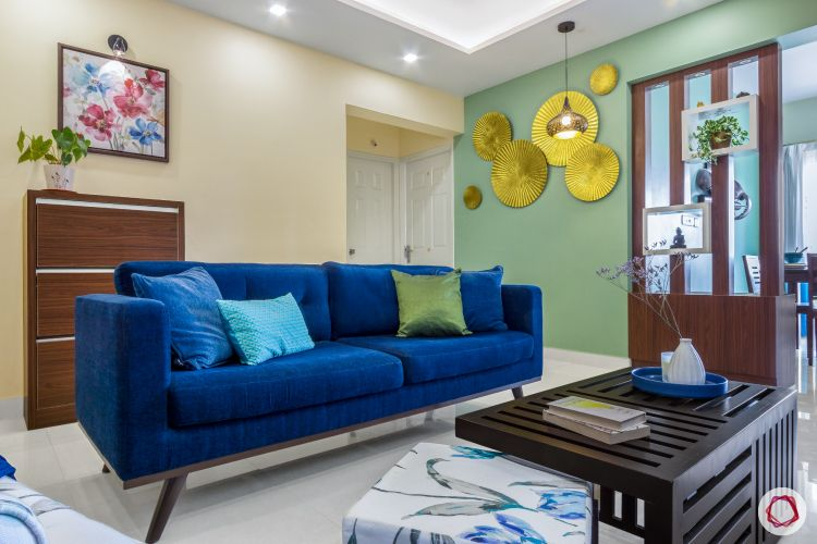 home bangalore-living room-seating area-centre table-golden wall art-wooden partition