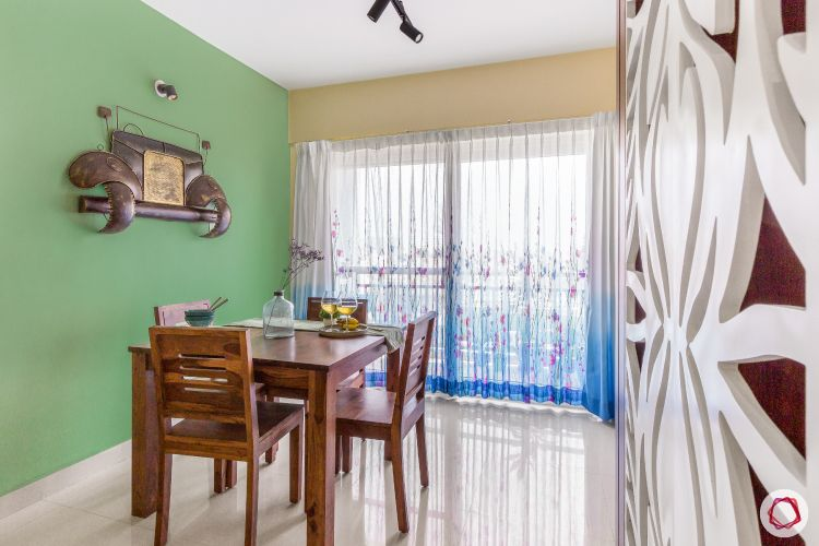 home bangalore-dining table-green wall-printed curtains