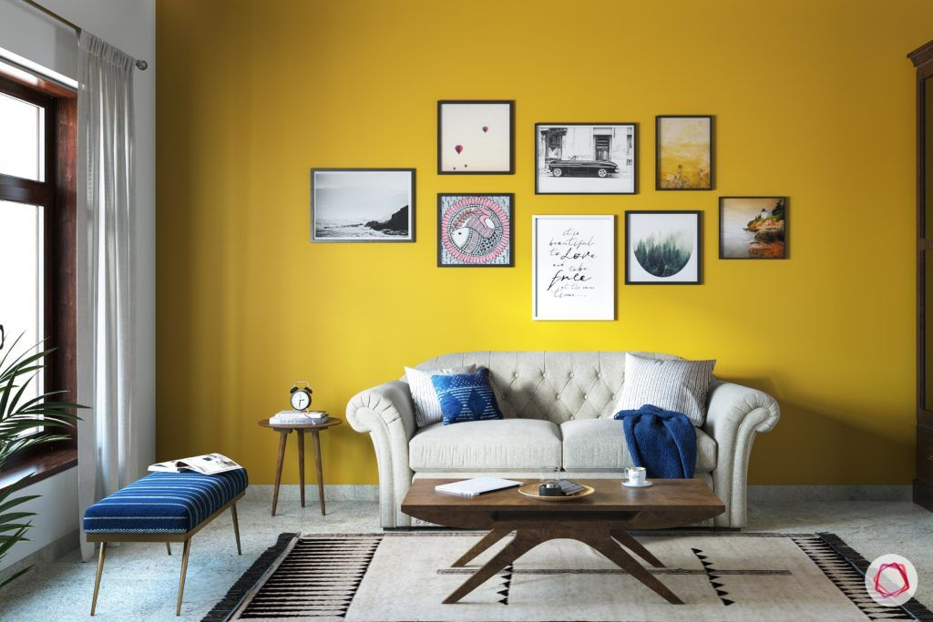 radhika apte-spare-room-curtains-bench-coffee-table-sofa-rug-yellow-wall