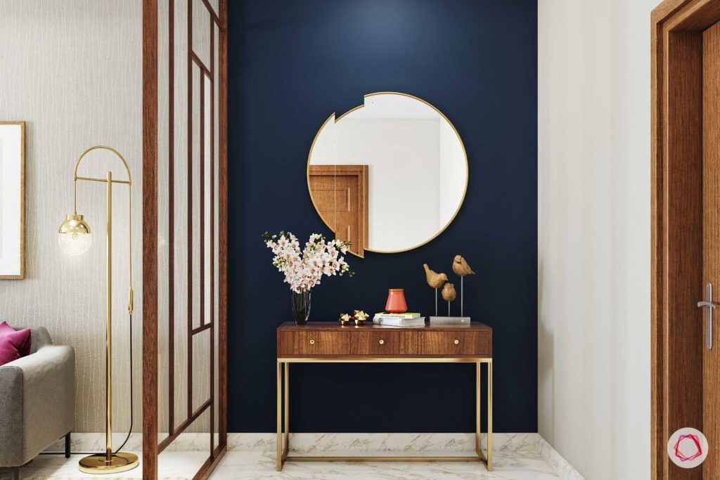 calming colors-navy blue wall paint-console designs-round mirror designs