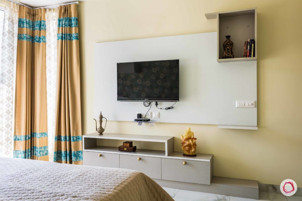 master-bedroom-TV-white-panel-curtains-cabinets