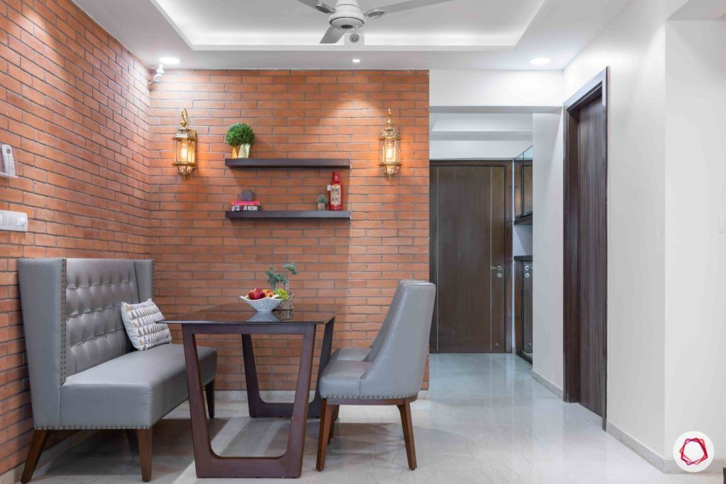 adani western-heights-exposed brick wall designs-dining set for small spaces