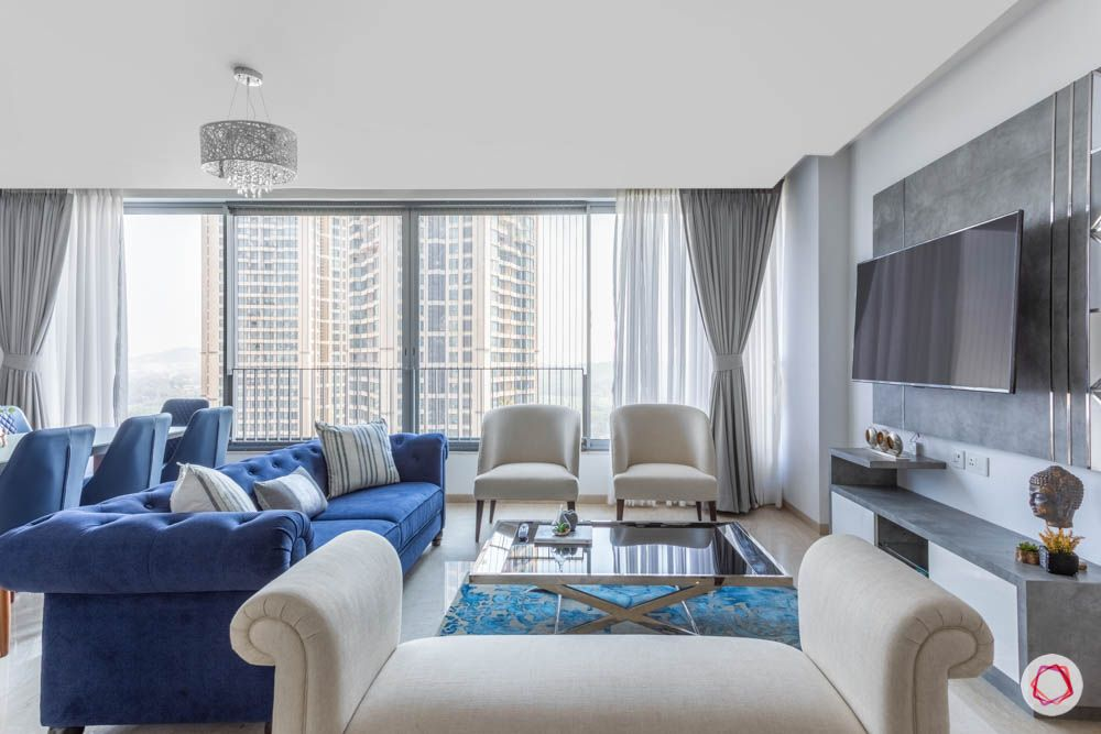 oberoi goregaon-living room-white daybed-blue chesterfield sofa-white chairs