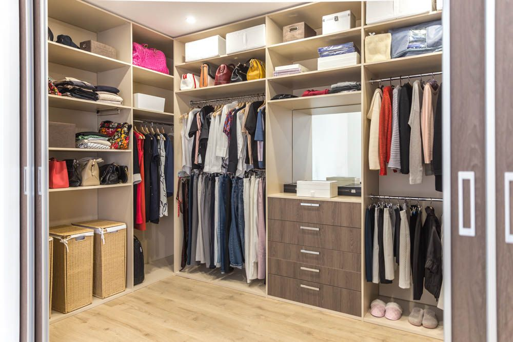 walk-in-wardrobe-shelves-mirror-table-shoes-clothes-wooden-flooring
