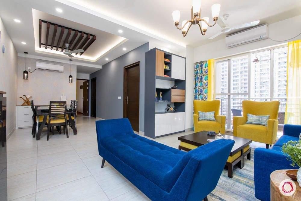 cleo county-living-cum-dining-room-yellow chairs-blue daybed