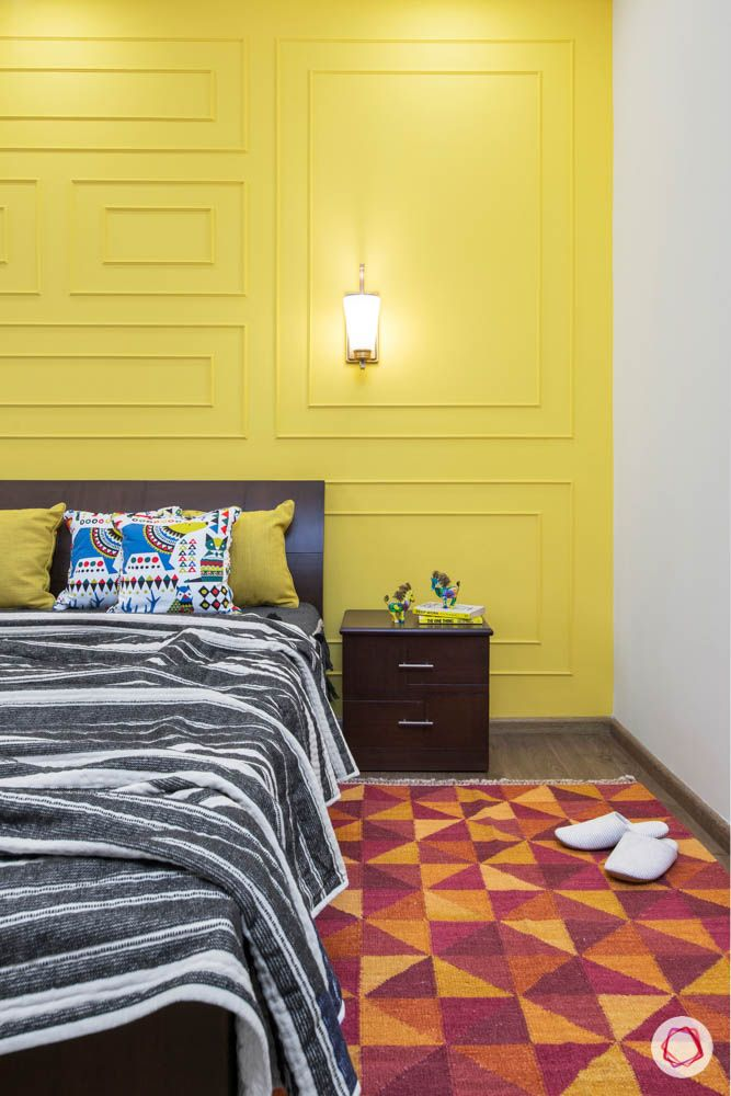 cleo county-guest bedroom-bedside table-yellow wall trims-bright room