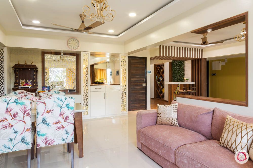 4 bhk flat in mumbai-combined living room-pink sofa-dining chairs