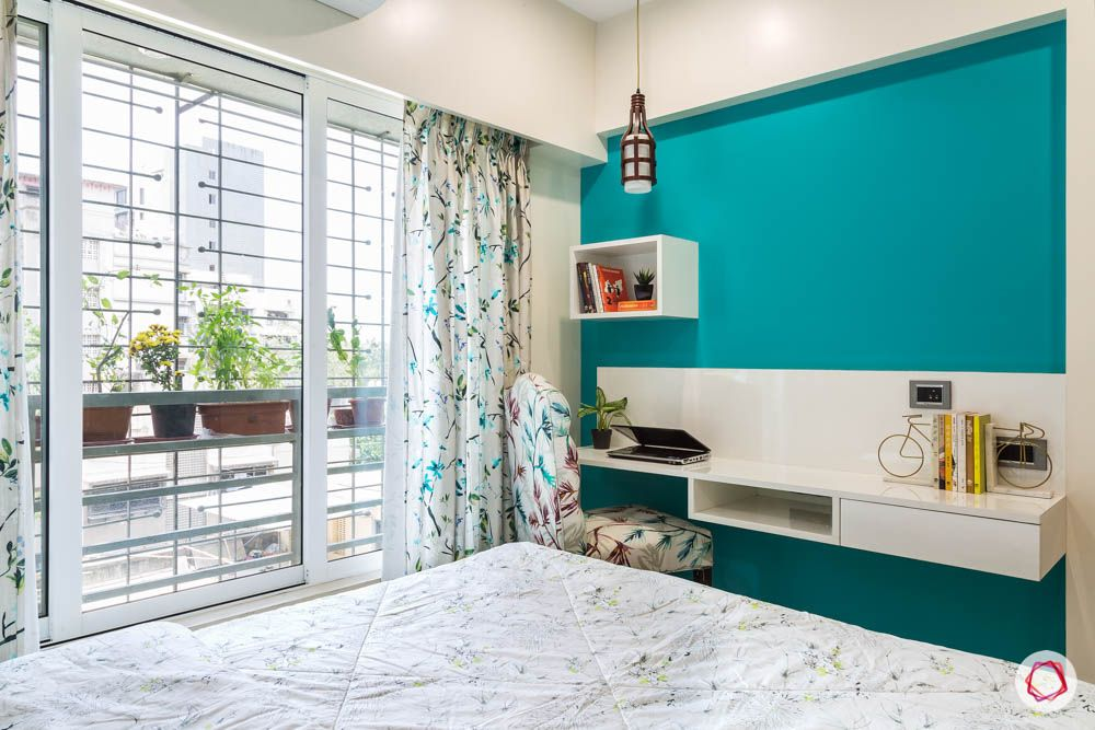 4 bhk flat in mumbai-guest bedroom-tv unit-turquoise wall
