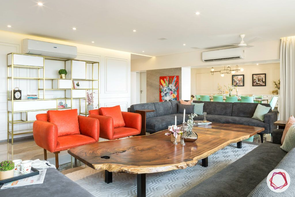 orange chairs-grey sofas-green dining table chairs