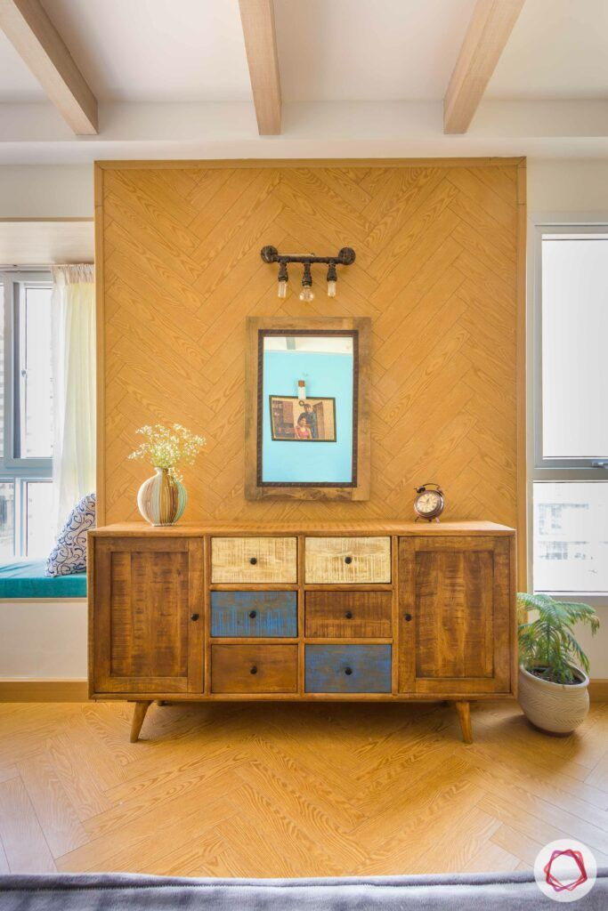 how to style a console-wooden-table-accent-wall-vase-flower-painting