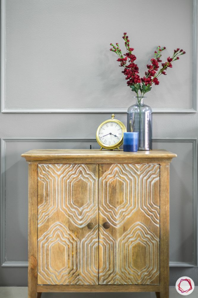 Indian console designs-grey wall-vase-flower-clock-candle